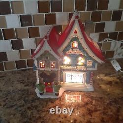 Deparment 56 north pole village Mickey's pin traders lighted house