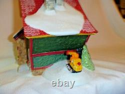 Dept 56 North Pole Village Dumpy's Toy Trucks building